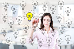 Business woman drawing a great idea concept. Office background. Stock Photo