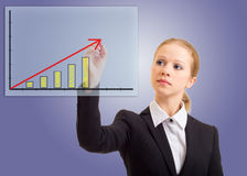 Business woman drawing a rising arrow. Representing business growth stock images