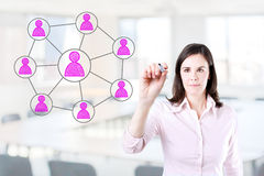 Business woman drawing social network connection. Office background. Royalty Free Stock Image