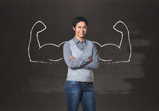 Business woman with drawn powerful hands. Black chalkboard background royalty free stock photos