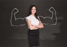 Business woman with drawn powerful hands. Black chalkboard background Royalty Free Stock Photography