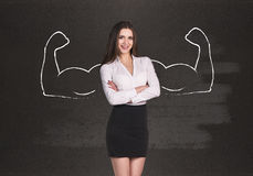 Business woman with drawn powerful hands. Black chalkboard background stock photos