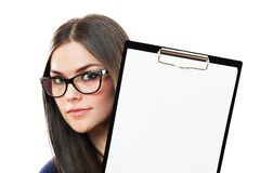 Business woman draws our attention on a copy space Stock Images