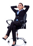 Business woman dreaming. Business woman leaning back in a black chair dreaming Royalty Free Stock Photography