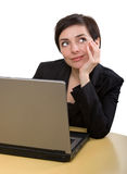 Business woman dreaming. Beautiful businesswoman dreaming at work with her laptop Royalty Free Stock Photo