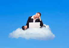 Business woman dreaming on a cloud Royalty Free Stock Photos