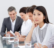 A business woman is dreaming in a meeting Royalty Free Stock Photography