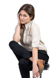 Business woman dressed in black trousers and brown shoes. Sits in a chair royalty free stock photography