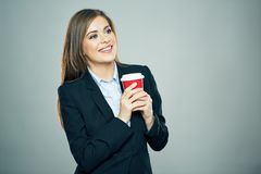 Business woman dressed offise style suit smiling and hold red c Stock Photo