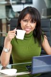 Business woman drinking coffee Royalty Free Stock Images