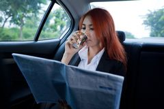 Business woman drinking coffee Stock Image