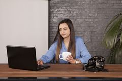 Business woman drinking coffee, copy space behind her back royalty free stock images