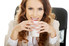 Business woman drinking coffee. Royalty Free Stock Image