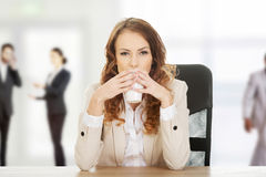 Business woman drinking coffee. Royalty Free Stock Photos