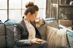 Business woman drinking coffee latte Stock Images