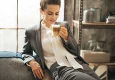 Business woman drinking coffee latte in loft Royalty Free Stock Photo