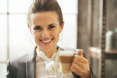 Business woman drinking coffee latte in loft Royalty Free Stock Photography