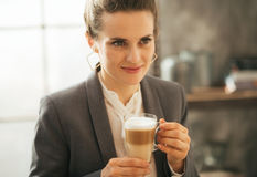 Business woman drinking coffee in loft apartment Royalty Free Stock Photo