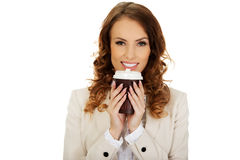 Business woman drinking coffee. Royalty Free Stock Photography