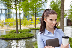 Business woman drinking coffee in a park Stock Images