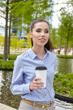 Business woman drinking coffee in a park Royalty Free Stock Images
