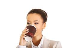 Business woman drinking coffee. Stock Photo