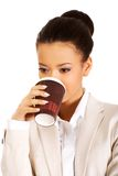 Business woman drinking coffee. Royalty Free Stock Photo
