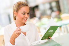 Business woman drinking coffee Royalty Free Stock Image
