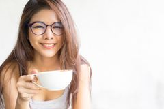 Business woman drinking coffee on white background. Happy young stock photos