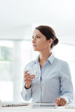 Business woman drinking a glass of water Stock Photo
