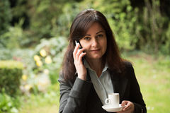 Business woman drinks coffee Royalty Free Stock Photos