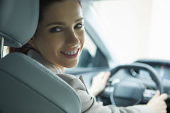 Business woman driving her new  car Royalty Free Stock Images