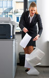 Business woman dropping documents Royalty Free Stock Photography