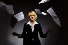 Business woman dropping heap of paper Royalty Free Stock Photo