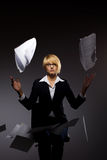Business woman dropping heap of paper. Beautiful young business woman dropping heap of paper Royalty Free Stock Photography