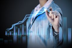 Business woman drowing media graphs Stock Images