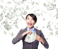 Business woman with earned money Royalty Free Stock Photography