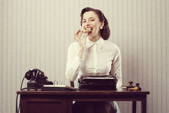 Business woman eating a cookie Royalty Free Stock Photography