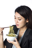 Business woman eating noodles Stock Images