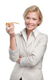 Business woman eating piece of pizza Royalty Free Stock Images