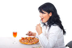 Business woman eating pizza Stock Photo
