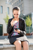 Business woman eating - problems Stock Photography