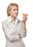 Business woman eating tasty pizza Stock Photos