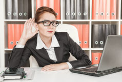 Business woman eavesdropping Royalty Free Stock Image