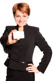 Business woman with empty card, focus on card. Beautiful business woman with empty card on white background Stock Image