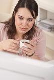 Business woman enjoying coffee at modern office Stock Images