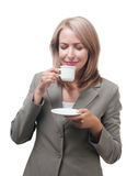 Business woman enjoying a cup of coffee isolated on white Stock Photography