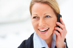 Business woman enjoying her conversation Royalty Free Stock Images