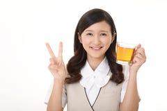 Woman drinking tea. Business woman enjoys cup of tea Royalty Free Stock Photo
