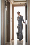 Business woman entering hotel room Stock Image